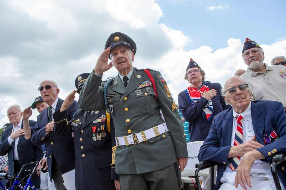 From left, World War II veterans Cyril Tozer,