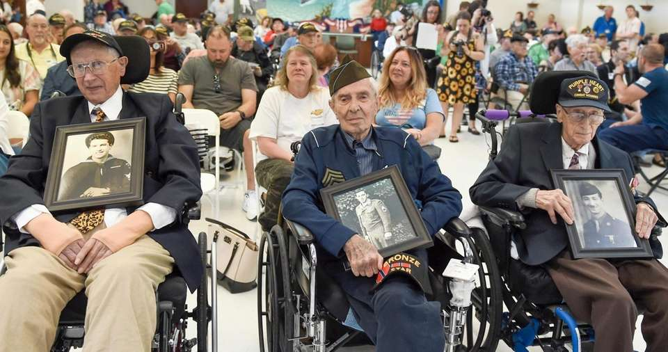 Normandy heroes Charles Cino, left, Phillip DiMarco and
