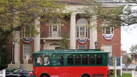 A modern-day trolley (actually a small passenger bus)