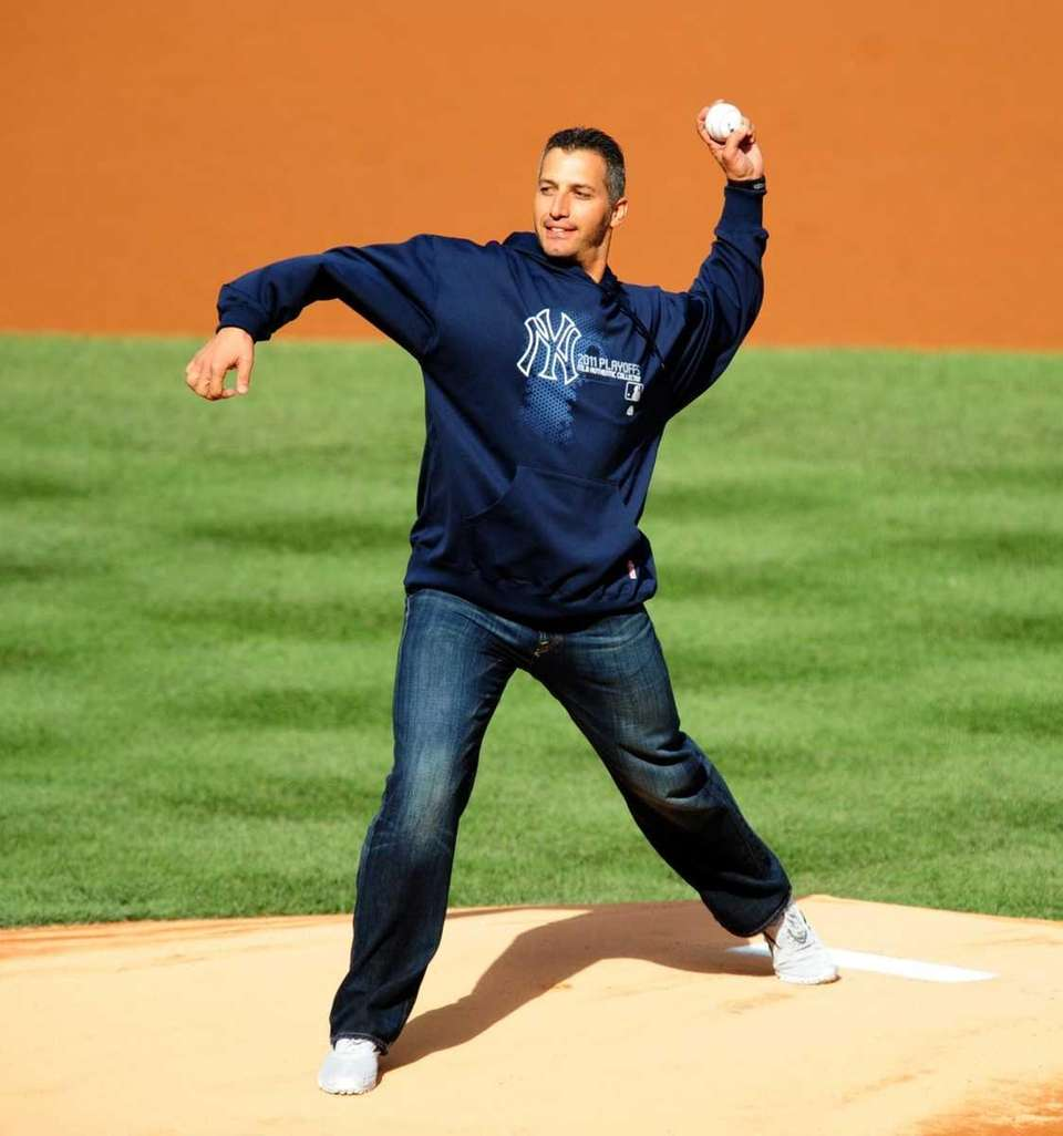 Former Yankees pitcher Andy Pettitte throws out the
