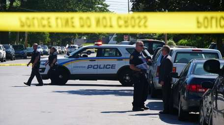 Police at the scene Sunday of a fatal