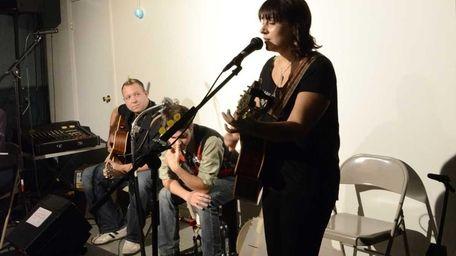 Jillian Santella of Glen Cove performs an original