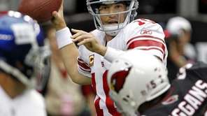 New York Giants quarterback Eli Manning throws under