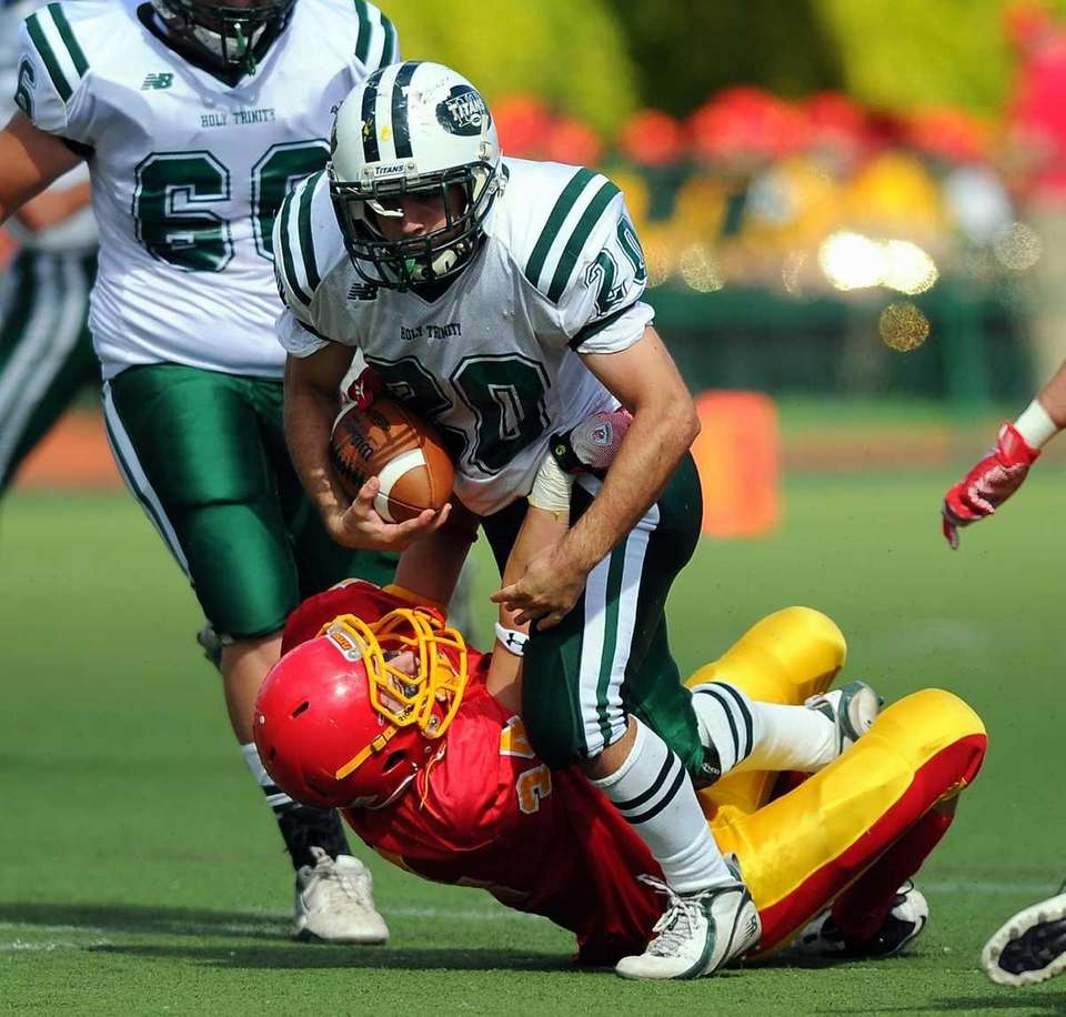 Holy Trinity's Michael Williams battles Chaminade's Christopher d'Ambrosio.