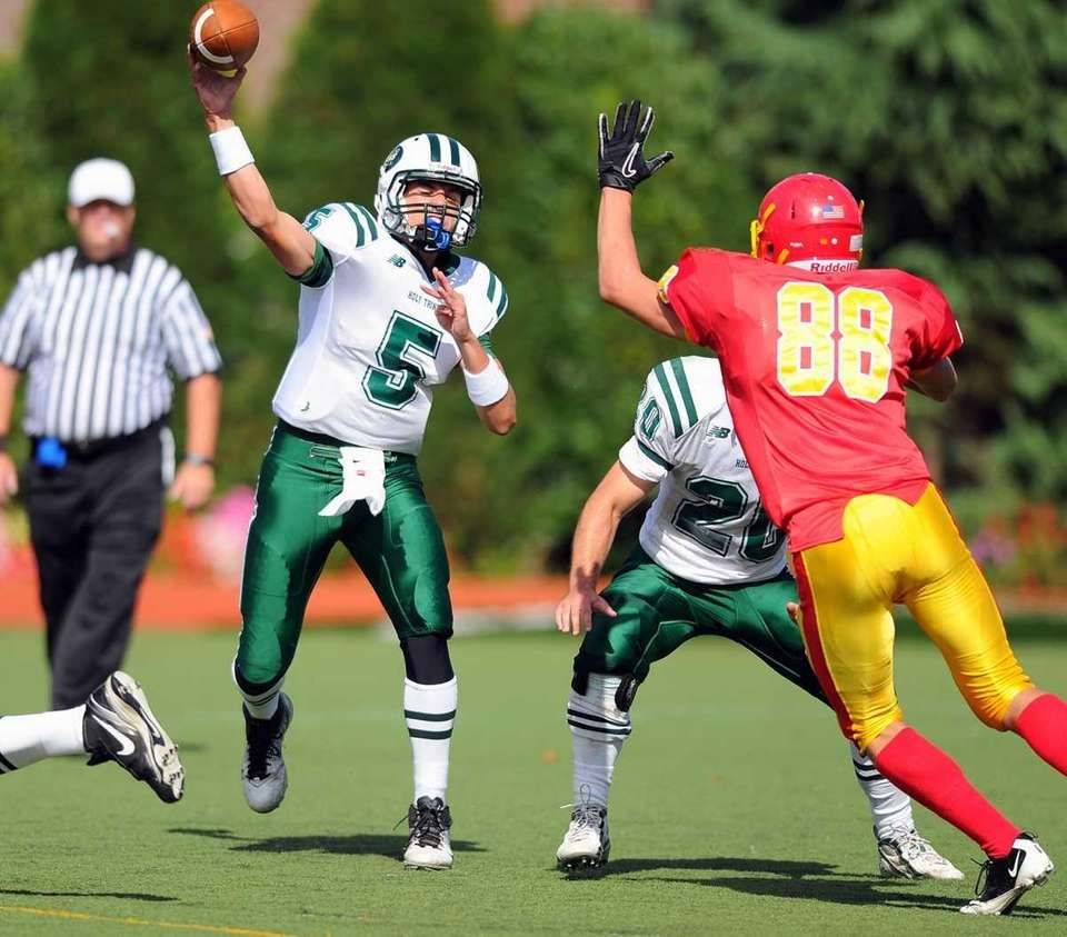 Holy Trinity's Christopher Laviano passes during Chaminade's 21-20
