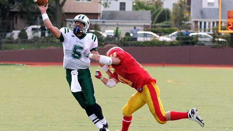 Holy Trinity's Christopher Laviano is hurried by Chaminade's