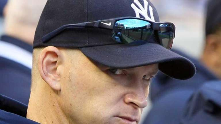 A.J. Burnett looks on from the dugout against