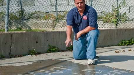 Michael Stracuzza shows off his grout seal on