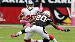 Victor Cruz makes a move on A.J. Jefferson