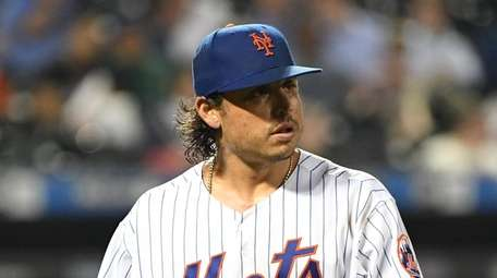Mets starting pitcher Jason Vargas walks to the