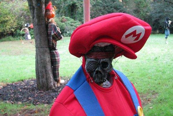 Shrunken Head Mario and other scarecrows on display