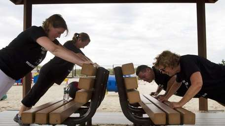 Participants in Jodi Lederer's boot camp exercise at