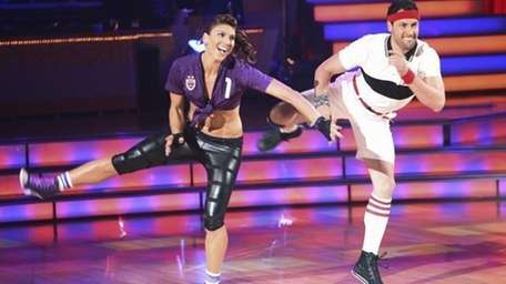 Hope Solo and Maksim Chmerkovskiy perform on