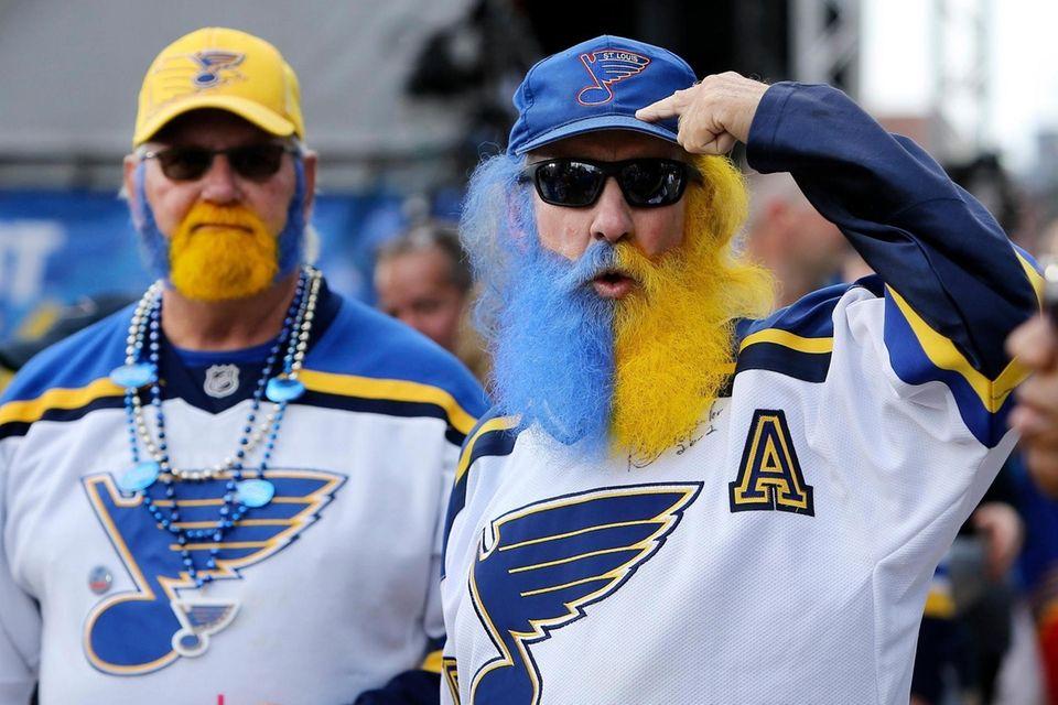 St. Louis Blues fans John Deifer, right, and