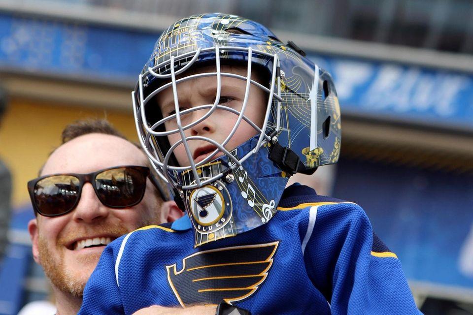 Beckham O'Brien wears a St. Louis Blues helmet