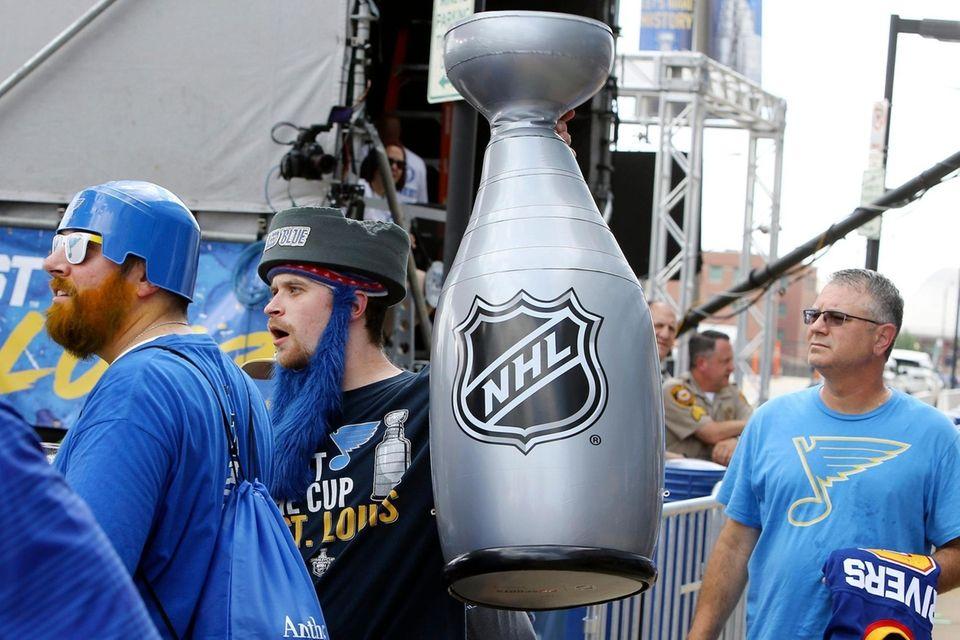 St. Louis Blues fan Kyle Taylor carries an
