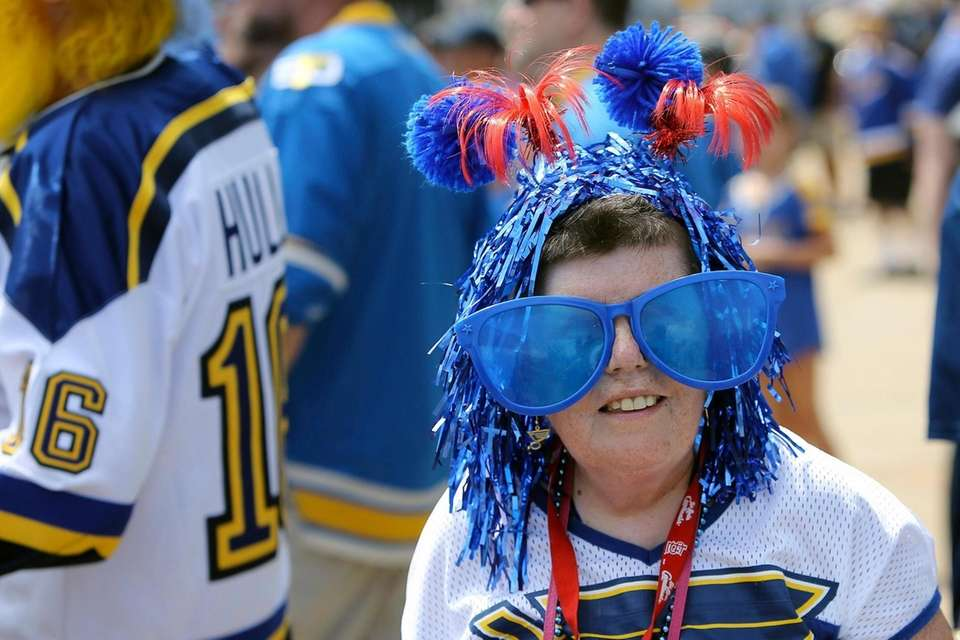 St. Louis Blues fan Mary Mariauty arrives at