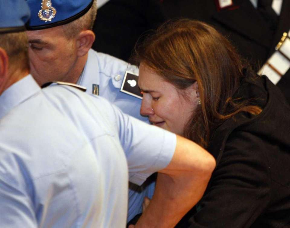 Amanda Knox breaks in tears as she is