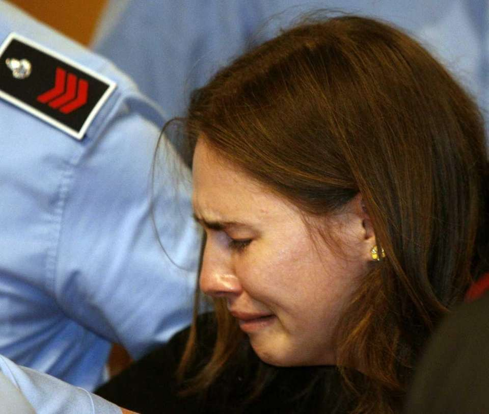 Amanda Knox breaks into tears as she is