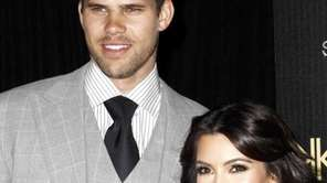 Reality TV personality Kim Kardashian, right, and her