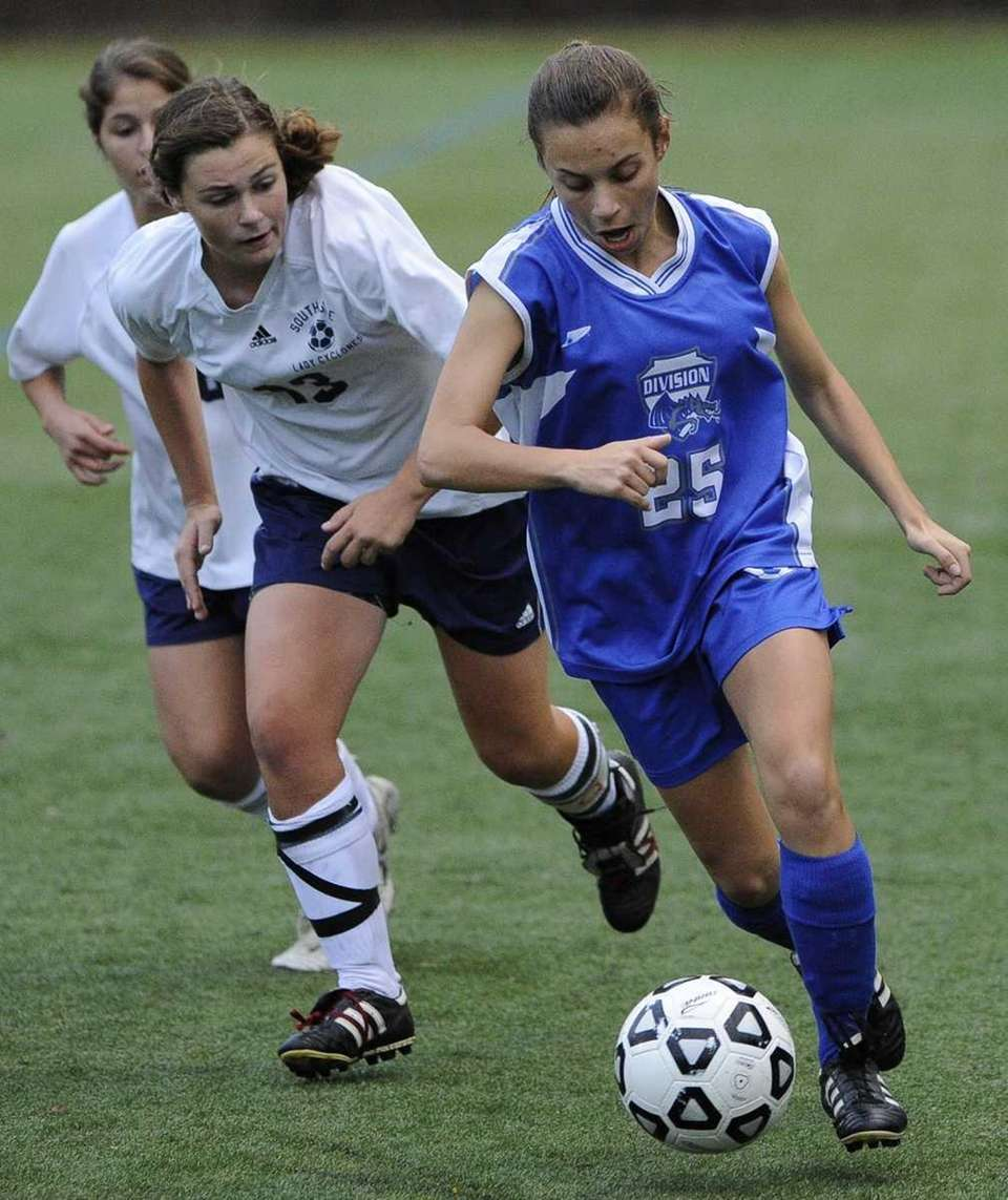 Division's Joanna Capitelli, right, controls the ball ahead