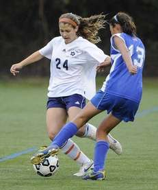 South Side's Alex Reis, left, defends against Division's