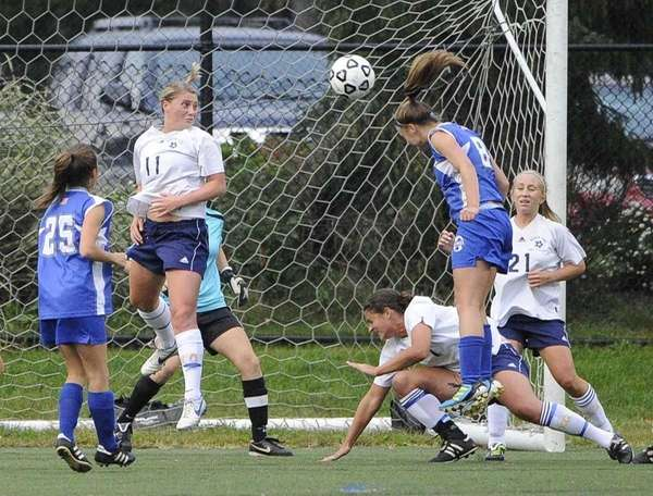 Division's Alexa Schneider heads the ball into the