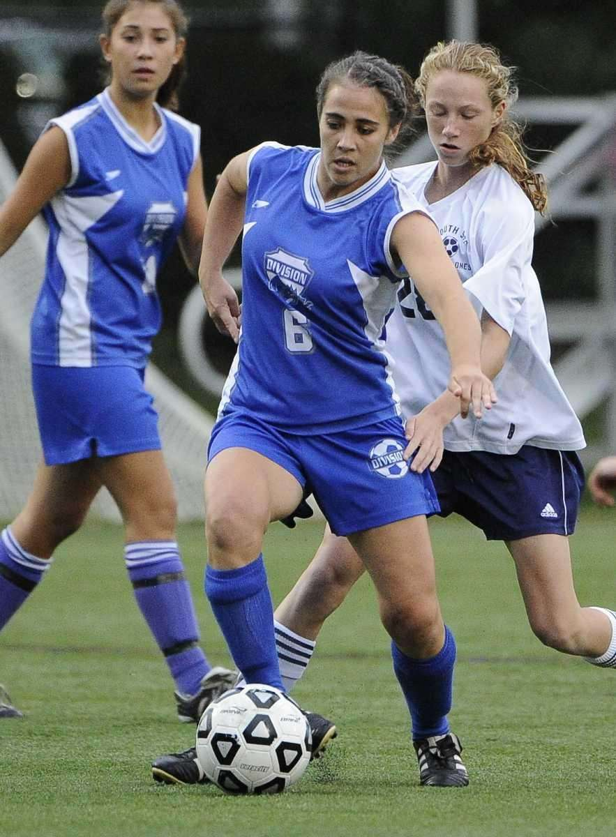 Division's Maggie Carew, center, controls the ball ahead