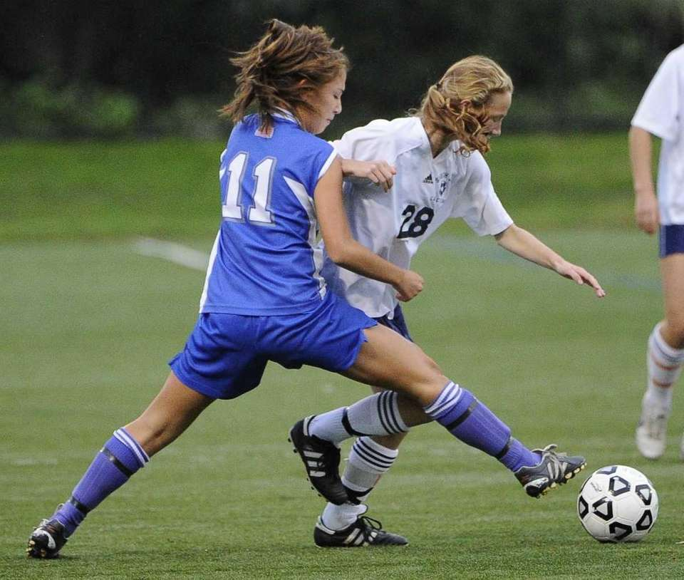 Division's Alyssa Fiore, left, keeps the ball from