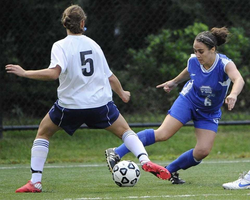 Division's Maggie Carew, right, controls the ball as