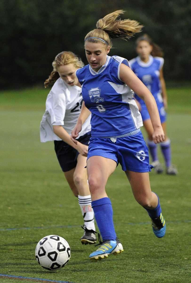 Division's Alexa Schneider, right, controls the ball ahead