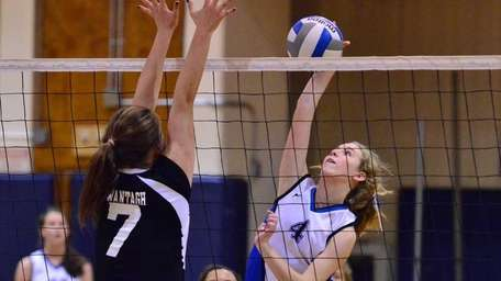 Mary McDonagh of Long Beach tries to spike