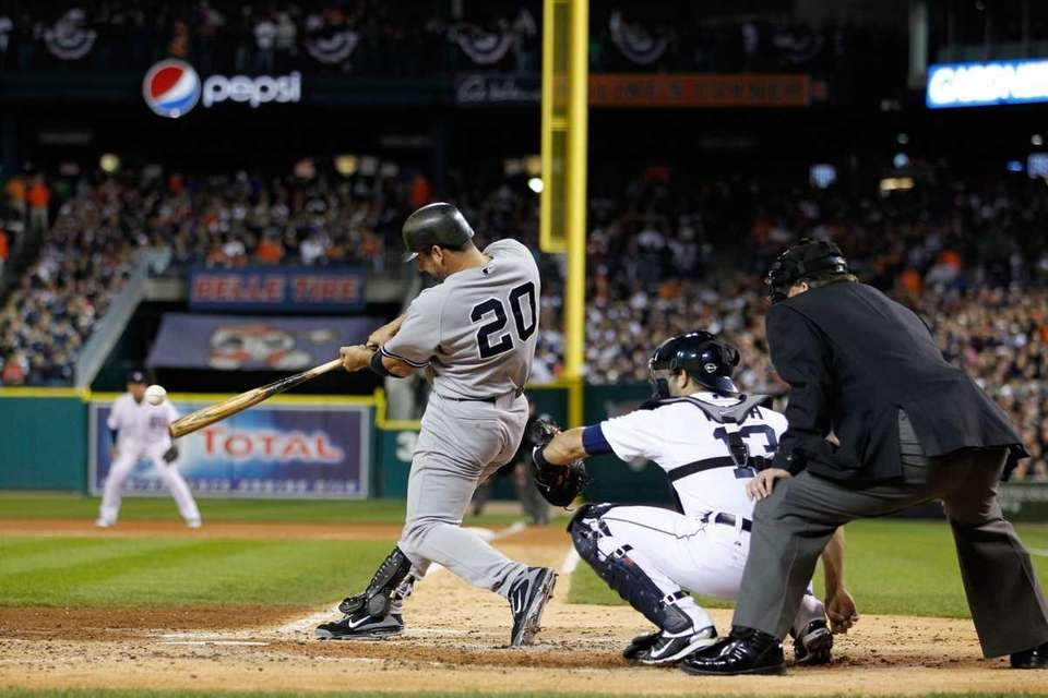 Jorge Posada hits a single in the second