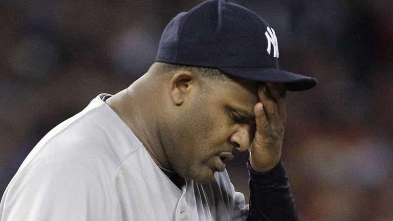 New York Yankees starting pitcher CC Sabathia wipes