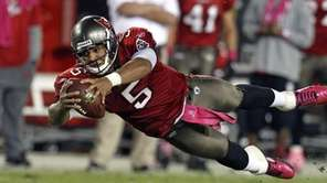 Tampa Bay Buccaneers quarterback Josh Freeman dives for