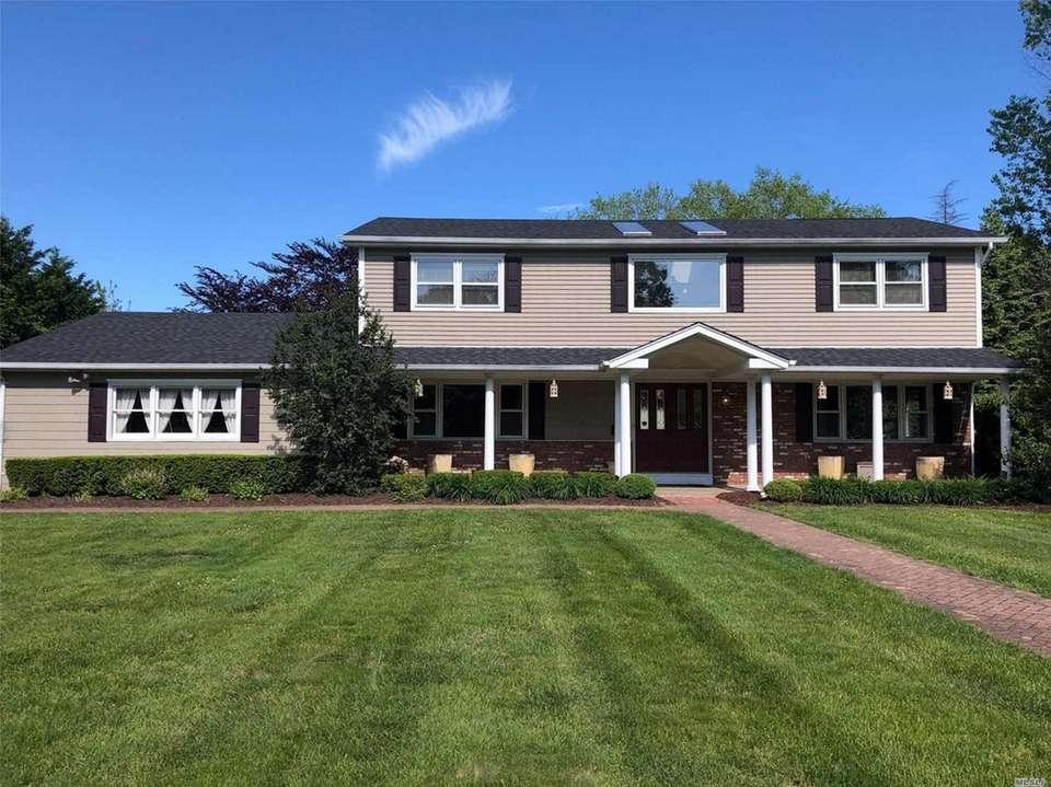 This Bayport Colonial includes three bedrooms and three