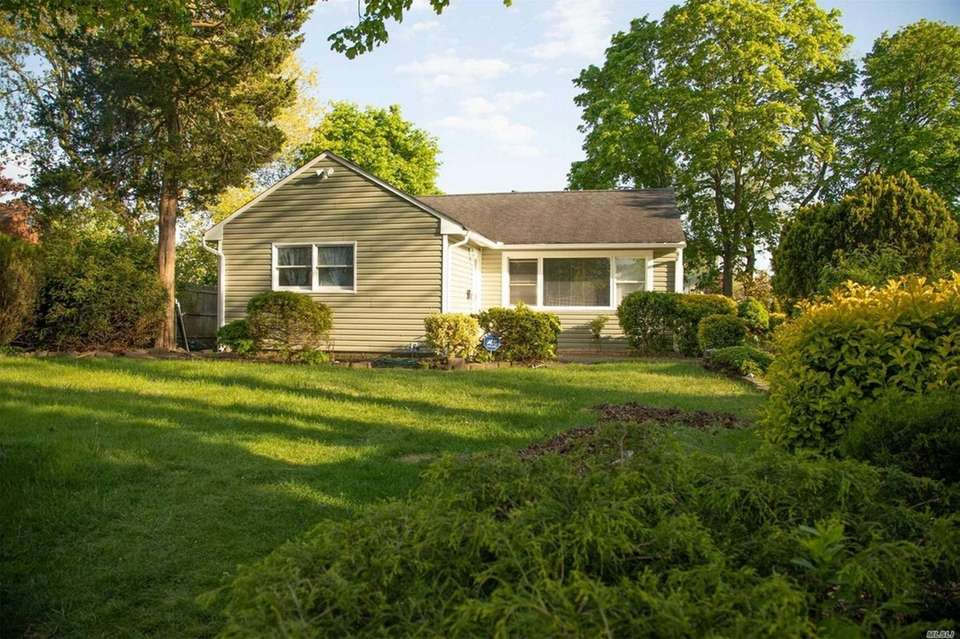 This Central Islip ranch includes three bedrooms and