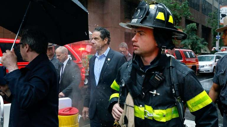 Gov. Andrew M. Cuomo and first responders walk