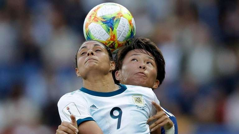 Argentina's Sole Jaimes, left, fights for a high