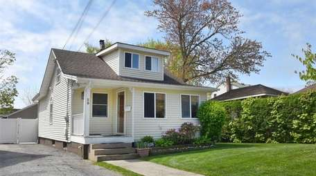 This Lynbrook two-bedroom, one-bathroom bungalow sits on a