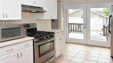 The Lynbrook bungalow's kitchen, with stainless steel appliances