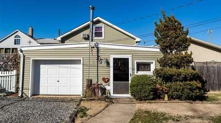 This East Rockaway expanded bungalow, with three bedrooms