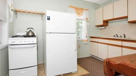 The kitchen inside a Northport bungalow listed for