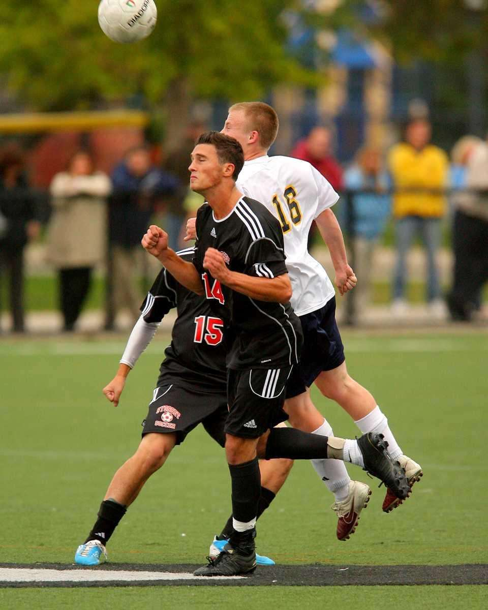 Syosset's Eric Bold #14 and Massapequa's Conor Tierney