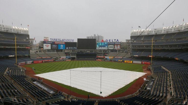 ALCS Game 4 postponed for rain, Yanks-Astros resume Thursday