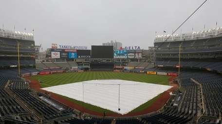 The tarp is out on the field prior