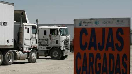 Semi-trailers loaded with goods to import prepare to