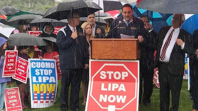 Residents and local officials rally Monday against LIPA's