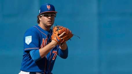 Mets pitcher Anthony Kay sets during a spring