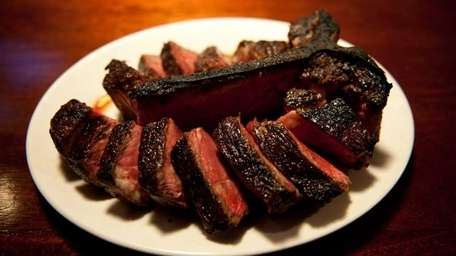 The porterhouse for two, sliced off the bone